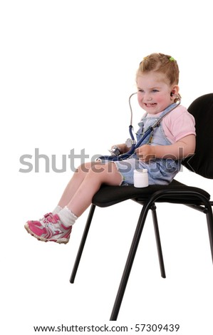 Small playful girl on chair with stethoscope isolated on white background - stock photo