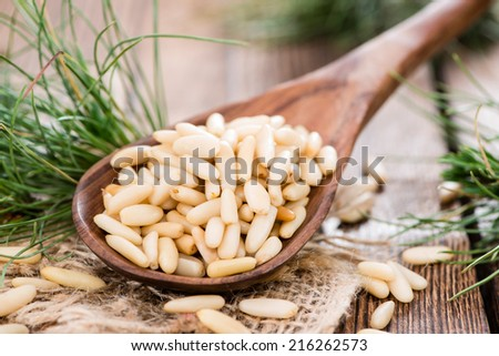 Small portion of Pine Nuts as detailed close-up shot - stock photo
