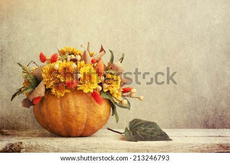 Small pumpkins with chrysanthemums - stock photo