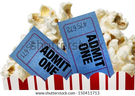 Small Red and White Bucket Of Popcorn With Two Blue Movie Tickets/ Movie Night Close Up On White - stock photo