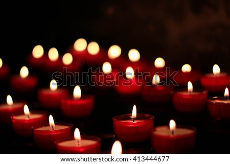 Small Red Burning Candles In The Dark - stock photo