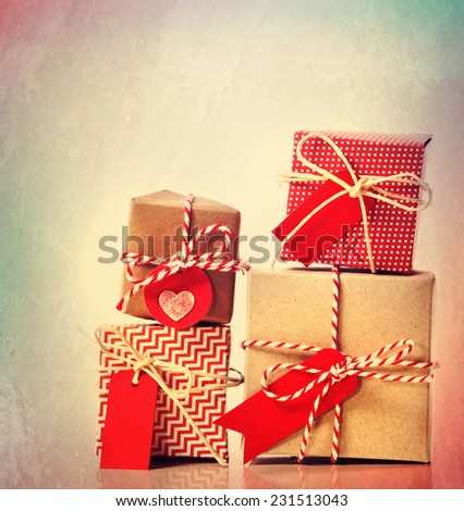 Small red handmade gift boxes on pastel background - stock photo