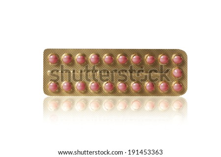 small red pills in a blister - stock photo