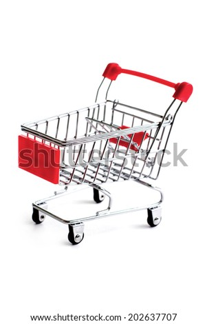 Small red shopping cart isolated over white background - stock photo