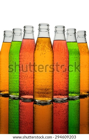 Small ribbed multicolor bottles and reflections - stock photo