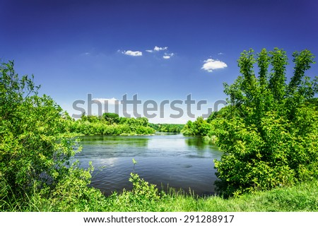 Small river and  blue sky. - stock photo