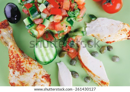 small roast meat chunks on green over white - stock photo