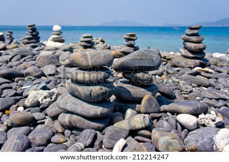 Small rock on the beach - stock photo