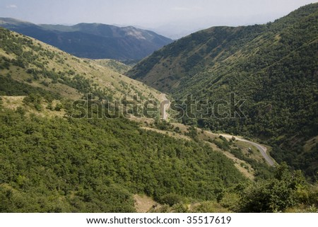 Small route in valley in Armenia. Big mountain, summer day. - stock photo