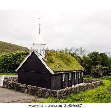 Small rural church with turf covered roof on the Faroe Island of Eysturoy, located between Iceland and the northwest of Scotland   - stock photo