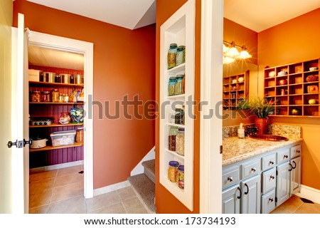 Small rust and white hallway with designed built-in shelves. Storage room and bathroom entrance - stock photo
