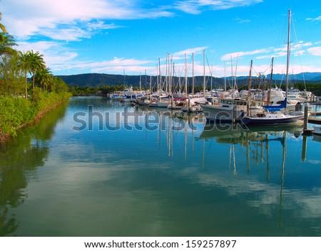 Small sailboats in the harbor in Port Douglas, Australia - stock photo
