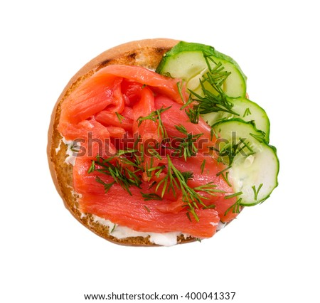 Small sandwich with salmon and cucumber isolated on white background. Top view. - stock photo
