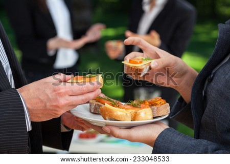 Small sandwiches on office meal during the lunch - stock photo