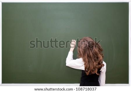 small schoolgirl about a blackboard - stock photo