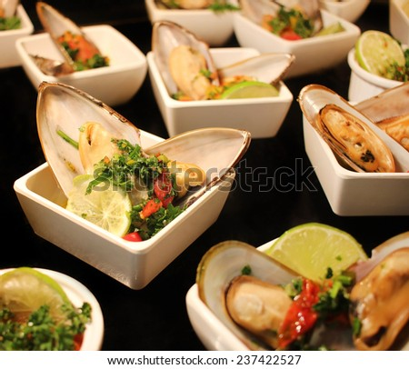 Small seafood appetizers at the restaurant - stock photo