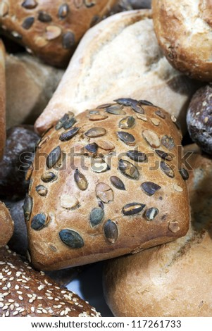 Small seeded bread loaves closeup - stock photo
