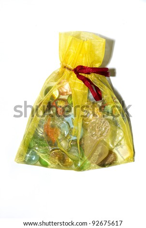Small shiny yellow present bag with a rope - stock photo