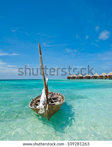 Small ship on the tropical coast in the Maldives - stock photo