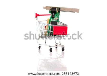 Small shopping cart with computer hardware, isolated over white - stock photo