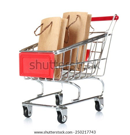 Small shopping cart with paper bags isolated on white - stock photo