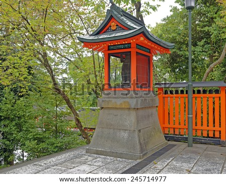 Small shrine on the grounds of the famous Fushimi Inari Shinto shrine in Kyoto, Japan - stock photo