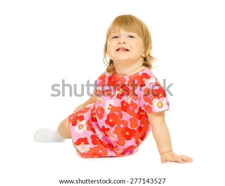 Small sitting baby in red dress isolated - stock photo