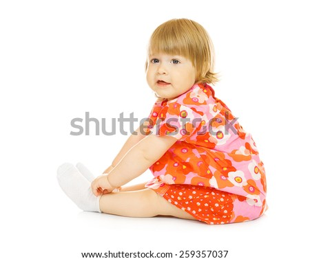 Small smiling baby in red dress isolated on white - stock photo