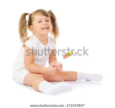 Small smiling girl with lollipop isolated - stock photo