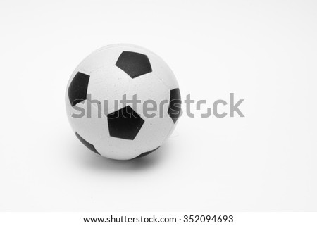 Small soccer ball isolated on the white background - black and white photo - stock photo