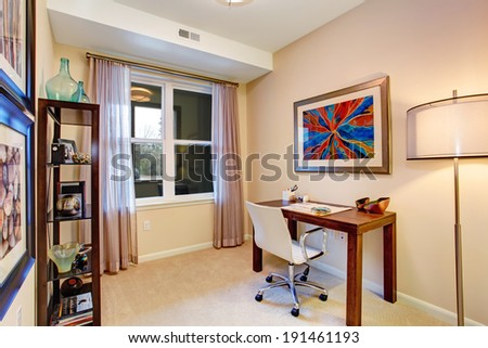 Small soft tones office room with desk and whirlpool chair - stock photo