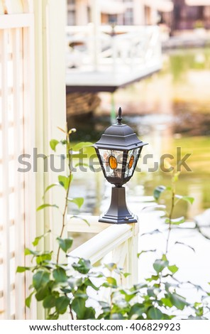 Small Solar Garden Light, Lanterns In Flower Bed.  - stock photo