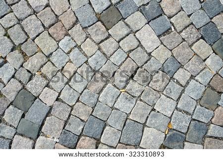 Small square cobblestone sidewalk for background texture - stock photo