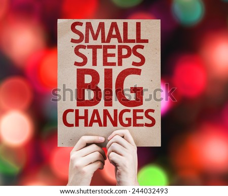 Small Steps Big Changes card with colorful background with defocused lights - stock photo