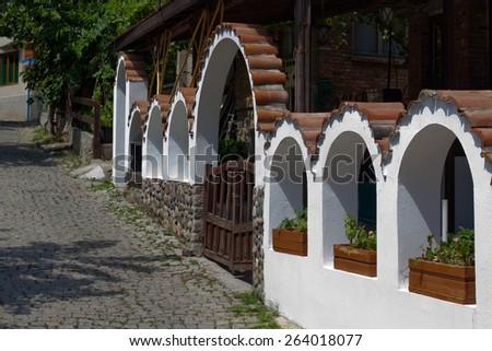 Small street in old town in Sozopol in Bulgaria - stock photo