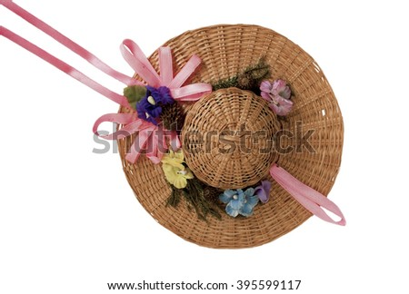 Small summer hat for doll isolated over white background - stock photo