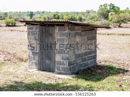 Small toilet of the farmland in countryside. - stock photo