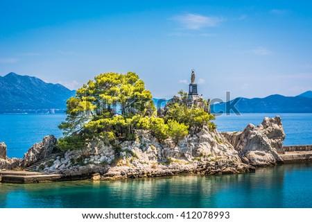 Small touristic place Trpanj on peninsula Peljesac, summer time, Croatia. / Croatia summer coastline waterfront. - stock photo
