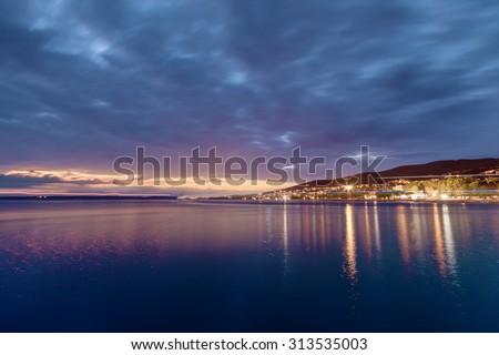 Small town Crikvenica on the Adriatic sea at night - stock photo
