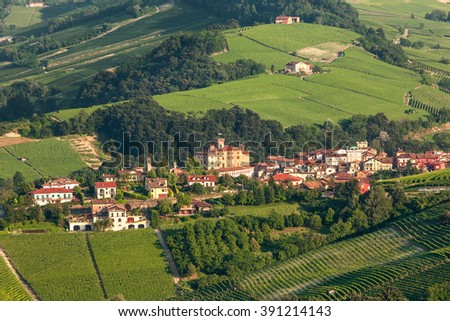 Small town of Barolo among green hills in Piedmont, Northern Italy. - stock photo