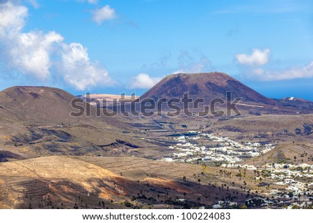 Small town of Haria in Lanzarote with palms in volcanic area - stock photo