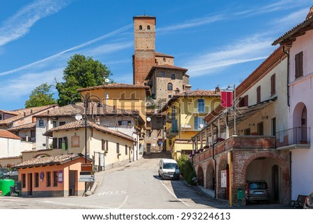 Small town of Serralunga d'Alba under blue sky in Piedmont, Northern Italy. - stock photo