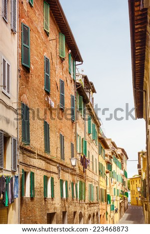 Small town street view in Sienna, Italy - stock photo
