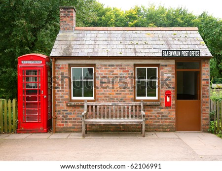 small traditional brick building with telephone box - stock photo