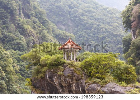 Small traditional Chinese pavillion perched atop a cliff in the mountains of Taroko National Park, Taiwan. - stock photo