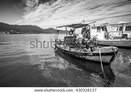 Small traditional Greek fishing boat in a port. - stock photo