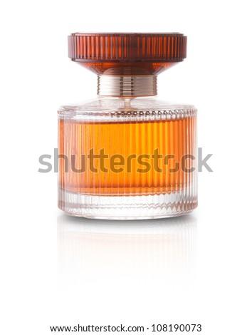 Small translucent orange perfume bottle on a white background - stock photo