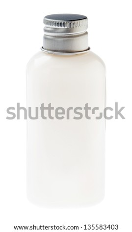 Small transparent plastic bottle filled with white cosmetic cream and sealed with a silver metal cap. The white contents of the bottle can be lotion, shampoo, etc. Isolated on white background. - stock photo