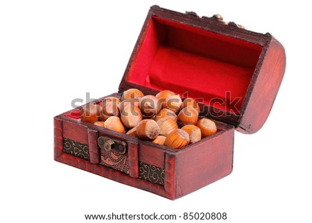 Small treasure Chest of hazelnuts isolated on a white background - stock photo