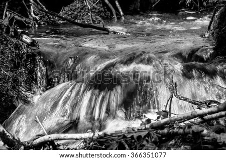 Small tributary stream along the country road in Quebec, Canada - stock photo